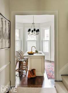A vintage rug from Hudson and Serena & Lily barstools keep the family kitchen cozy and casual.