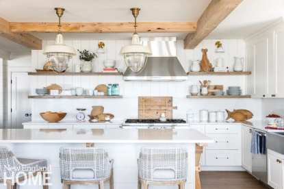 Clear-acrylic hardware with weathered-brass detailing adds the slightest hint of glam to this modern-farmhouse kitchen with coastal undertones.