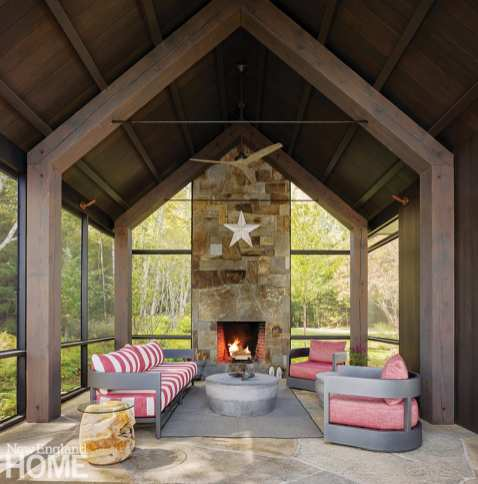 Large screened. porch with a stone floor andfireplace