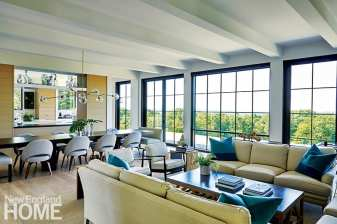 Floor-to-ceiling windows along the western-facing back wall of the house deliver breathtaking views. Custom pillows mimic the vistas, which are three-quarters sky.