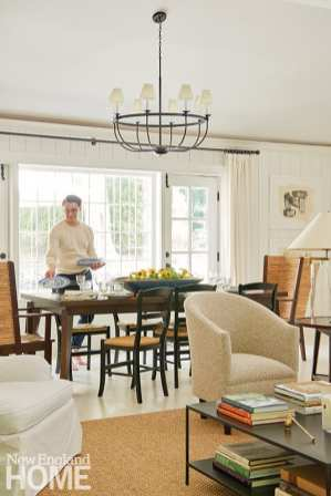 Puiia sets the table in the family room, which is used for informal entertaining.