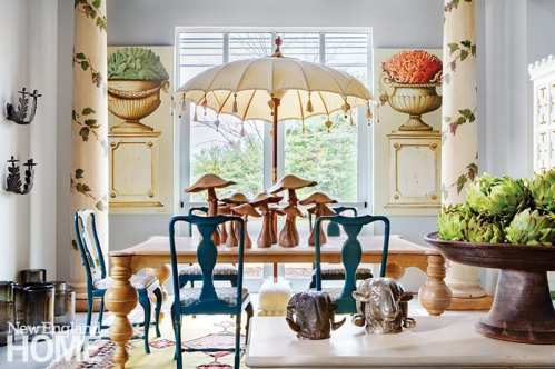 This tableau showcases hand-crafted poplar mushrooms from France; the urn paintings are by Vittoro Splendore.