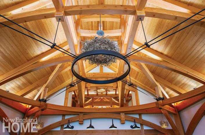Because a timber frame absorbs so much light, selecting the right lighting was critical; the goal of incorporating lots of strip and indirect lighting was to see the light but not the source.