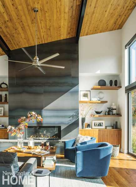 The great room features a fireplace surround constructed of hot-rolled steel panels custom fabricated by Chelsie Bush of Burnt Bearing Studios, as well as built-ins and a coffee table made by Lake Elmore, Vermont-based Whitaker Hartt Cabinetry.