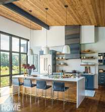 Likewise, island pendant lighting by Rejuvenation scales the high steel-beam-and-wood ceilings in the kitchen; Simpson Cabinetry crafted the cabinets, and Chelsie Bush created the steel range hood.