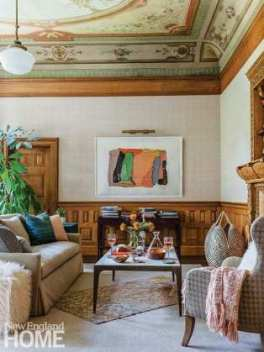 """: LeBlanc describes the mezzanine's ceiling as """"the belle of the ball;"""" a blush-toned wallcovering paired with neutral furnishings and carpets let it shine."""