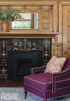 In the family room off the kitchen, an eggplant-colored chair from Ambella Home with Nobilis upholstery pops alongside the intricate original mosaic-tile fireplace surround.