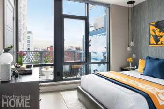 Masculine guest bedroom Boston high-rise.