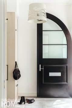 entryway with black door