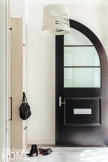 entryway with black door