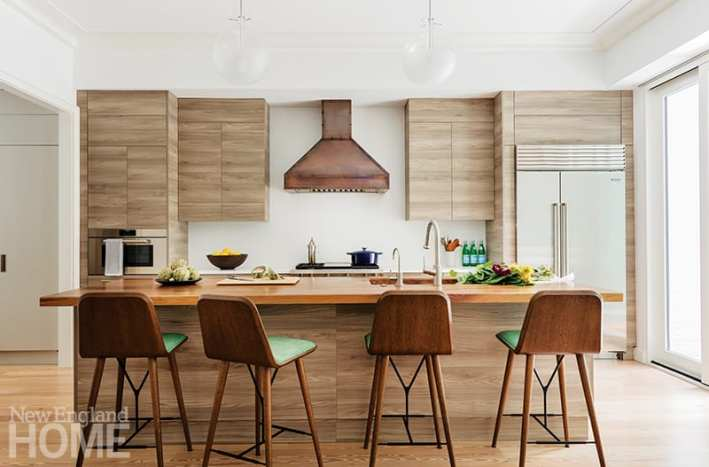 Contemporary Boston kitchen with bronze vent hood