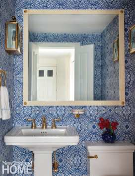 The garden-level powder room was treated to a bold Thibaut wallpaper.