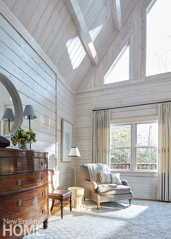 Seating area of main bedroom with white paneling