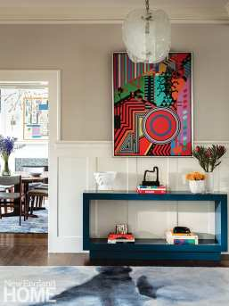 Entryway with console and contemporary art