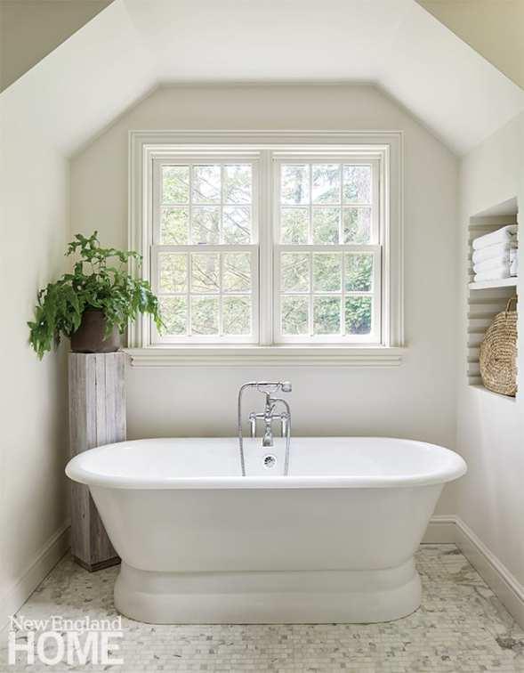 Bathroom with freestanding white tub.