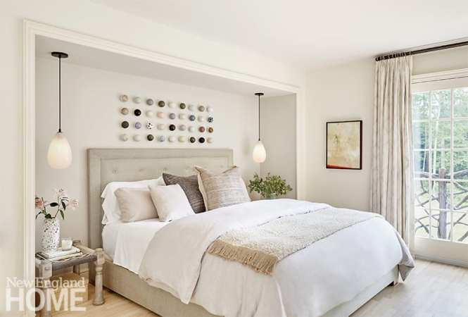 Primary bedroom with white and beige bedding.