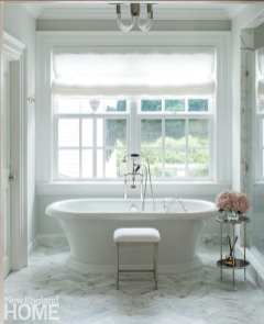 Walsh reconfigured and updated the existing main bath—which had formal, dated wallpaper and a black-and-white checkered floor—with a tub from MTI Baths and floor tile from Waterworks.