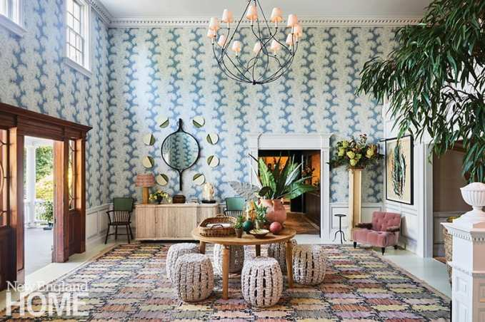 The recently redesigned lobby by Celerie Kemble at the Mayflower Inn & Spa in Washington features a whimsical wallpaper that plays up the room's dramatic height to great effect; the buffet and mirror are by William Yeoward.