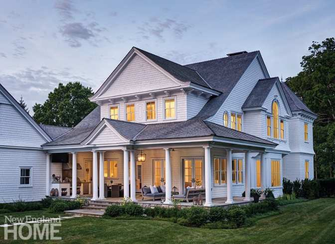Architect Robert Butscher of Wadia Associates incorporated a wealth of detail to every elevation of the Shingle-style home, even the back and sides. Painting the house white gave the classic design a contemporary feel.
