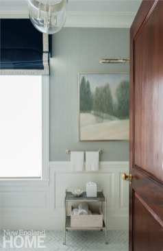 Bathroom with a painting by Carole McClintock