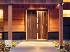 Pierced with metal and glass, this veneered door forced us to rethink traditional construction methods. From an unconventional core construction to RFID enabled access and an electromagnetic latch system, everything about this door required us to invent new solutions. Photo by Susan Teare.
