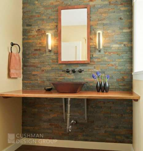 A material mix of Vermont slate and maple give this bathroom a sense of place. Photo by Susan Teare.