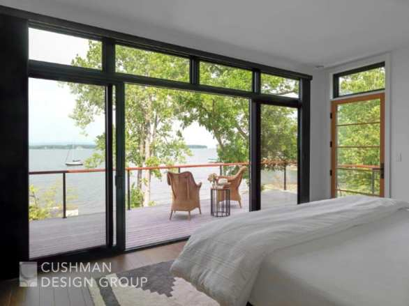 Homeowners can enjoy the outdoors cozily ensconced on a deck adjacent to the main bedroom of a lake-front home. Photo by Susan Teare.
