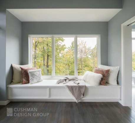 It is no surprise that this window seat with a dramatic view is a family favorite. The seat is so large it doubles as a sleeping area for overflow weekend guests. Photo by Lindsay Selin.