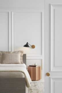 Proper task lighting is essential for reading in bed. Here Visual Comfort's Charlton Wall Light designed by Aerin Lauder is shown in an on-trend mix of antique brass and black.