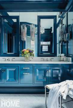 Benjamin Moore Gentleman's Gray in a high-gloss finish adds drama to the third-floor main bath.