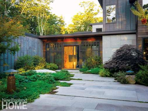 Entrance to contemporary Maine home with granite pavers.