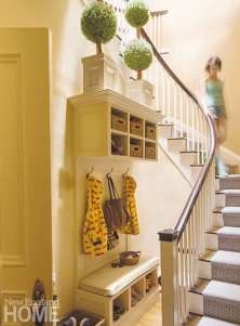 . In a once-awkward space under the stairs, a mini mudroom keeps the family of four organized.
