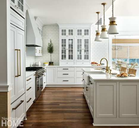 White kitchen with brass accents