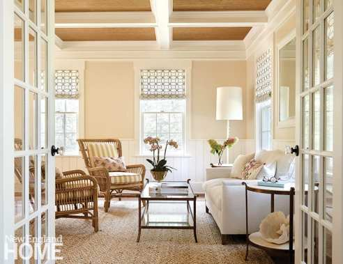 Seating area with white couch and rattan chairs
