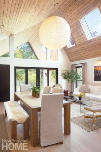 Interior of A-frame guest house with wood ceiling