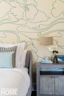 Bedroom with light blue and white wallpaper.