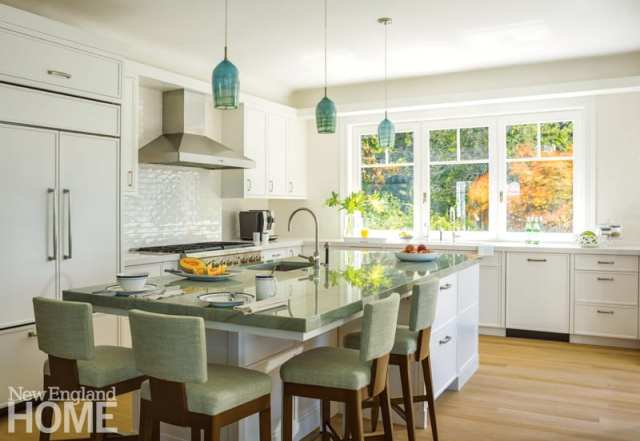 Cape Cod kitchen with white cabinets and teal pendant lights.