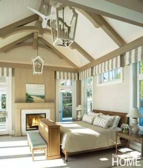Beige bedroom with vaulted ceiling.