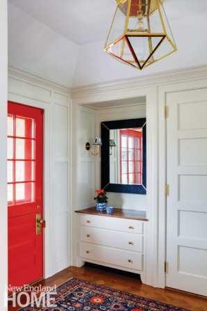 Entryway with bright red door.