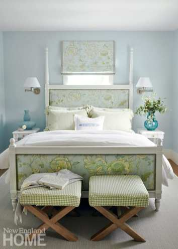 Guest bedroom with an upholstered bed.