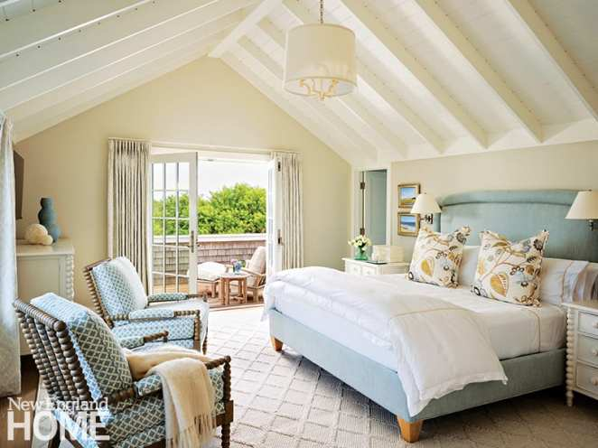 Main bedroom with white cathedral ceiling.