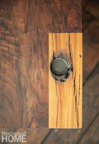 Each piece retains the wood's imperfections, and many have personal touches added by the artist, such as a scrap of a love note secreted in this round hole.