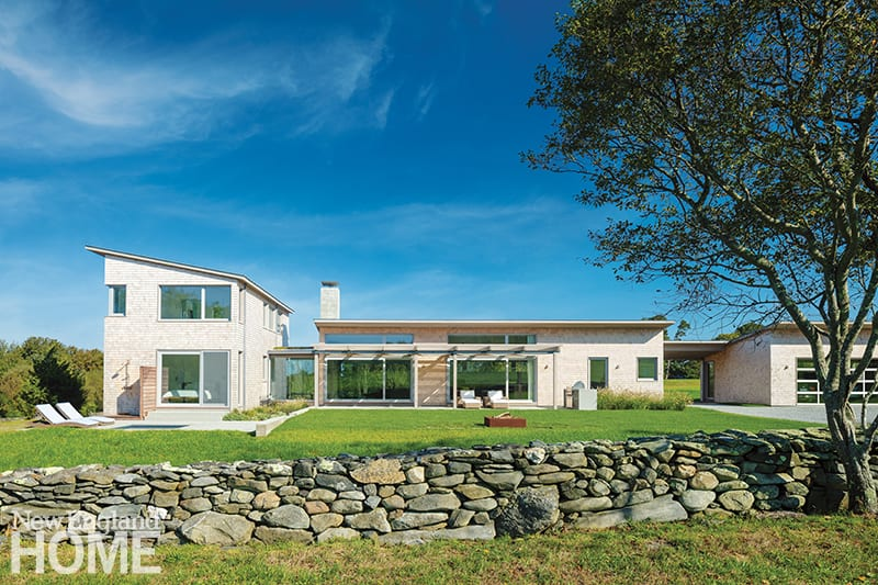 Contemporary home with stone wall