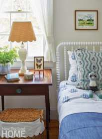 Jenny Lind bed with blue and white linens