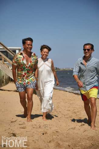 Wolhardt walks the beach with clients and close friends Ricardo Rodriguez (left) and Michael Kelley (right).