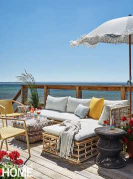 For a casual summer home right on the beach, interior designer Alina Wolhardt took inspiration from the natural landscape. Inside and out, relaxed frills, like the ottoman's pom-poms, elevate the sense of fun.