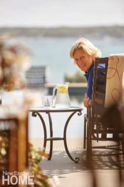 """Homeowner Maggie White, informally known as """"the mayor of Edgartown,"""" relaxes poolside."""