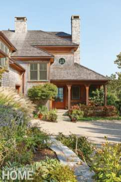Front entrance of shingle style home.