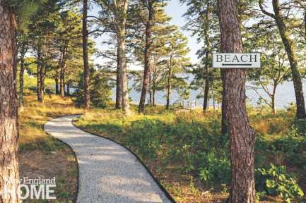A path winds through oak and pine trees to a private beach.