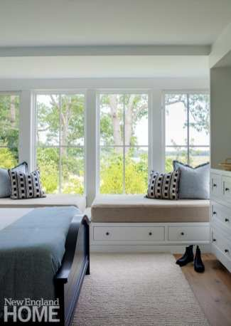 Two built-in bunks share a dreamy view in one of three bedrooms designed with the clients' sons in mind.